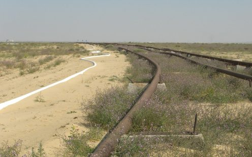SoluForce next to steel pipe desert